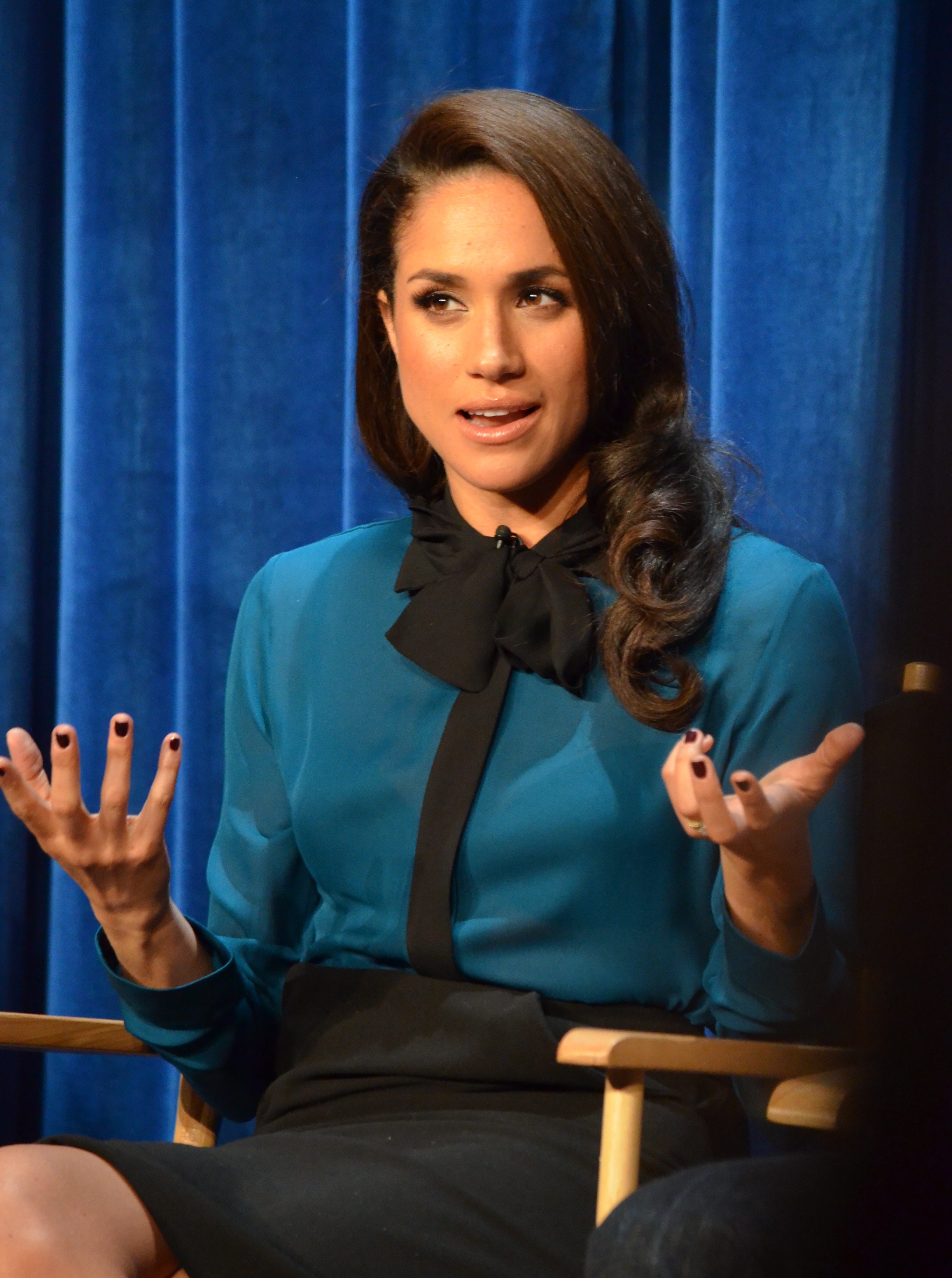 "© Genevieve (https://commons.wikimedia.org/wiki/File:Meghan_Markle_(Paley_Center_'Suits')_01_(cropped).jpg), ""Meghan Markle (Paley Center 'Suits') 01 (cropped)"", https://creativecommons.org/licenses/by/2.0/legalcode"